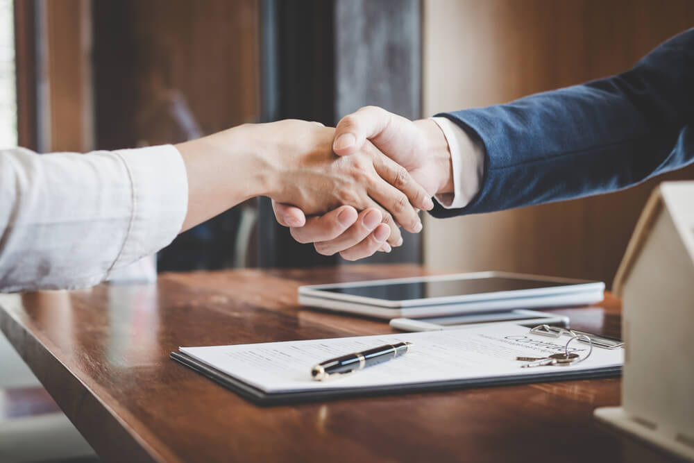 Business people in a handshake agreement in an office
